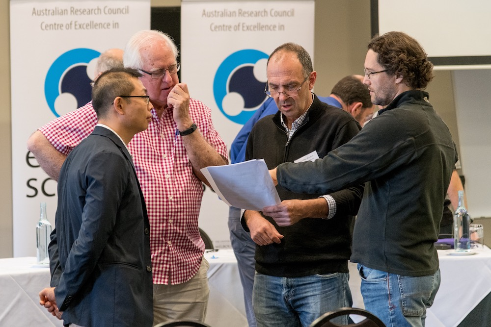 Centre Director Prof Paul Mulvaney, speaks with Chief Investigators Dr Wallace Wong, Prof Ken Ghiggino and Dr Asaph Widmer-Cooper.