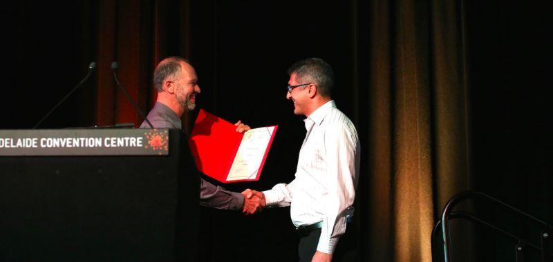Banner Joh Sader Accepts Award