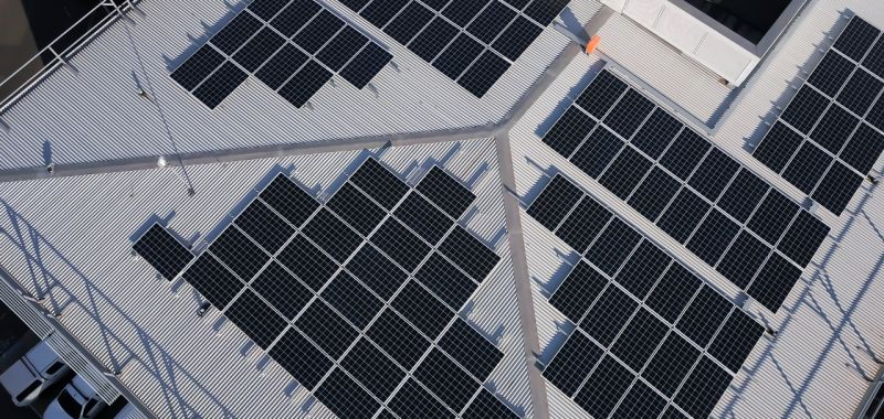 An aerial image of silicon solar panels mounted on a rooftop at Monash University's Clayton campus