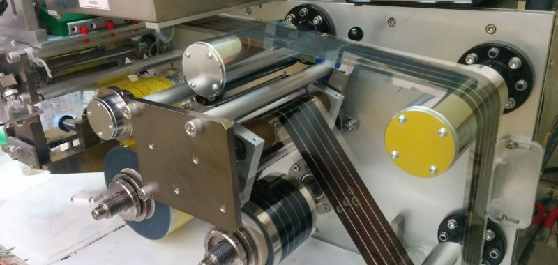 An image of a roll to roll device for printing perovskite solar cell materials