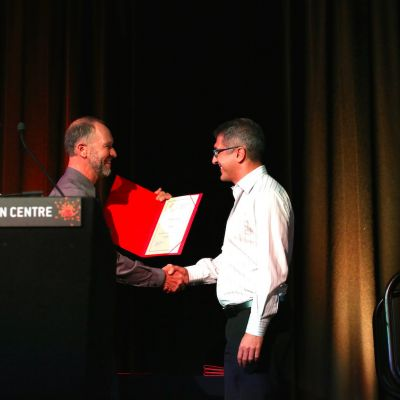 Banner Joh Sader Accepts Award