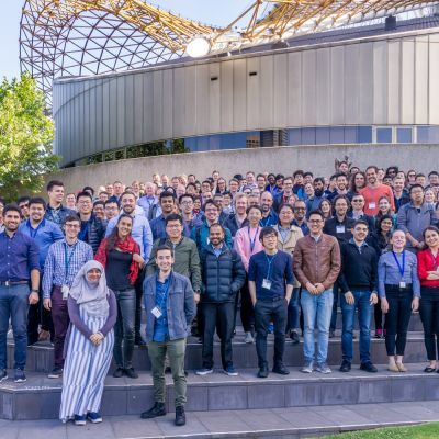 An image of the members of Exciton Science standing together in a large group outside the Arts Centre Melbourne in December 2019.