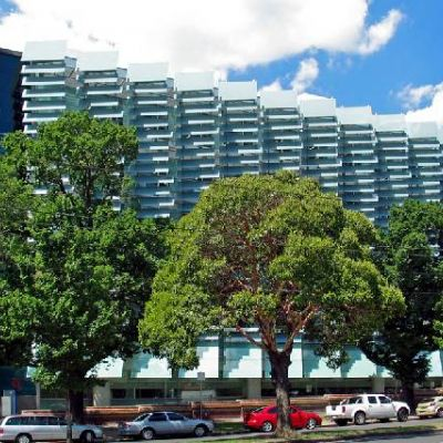 An image of a glass-fronted multistorey building on University of Melbourne's Parkville campus