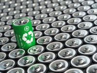 An image of a green battery with the recycling symbol among a number of other conventional batteries